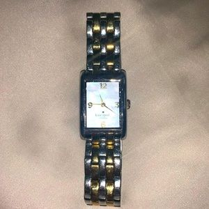 Kate Spade gold and silver watch with pearl face.